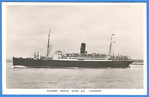 Black and white antique photo of a large steam ship. Port side, one funnel, two masts. Land can be seen behind the ship