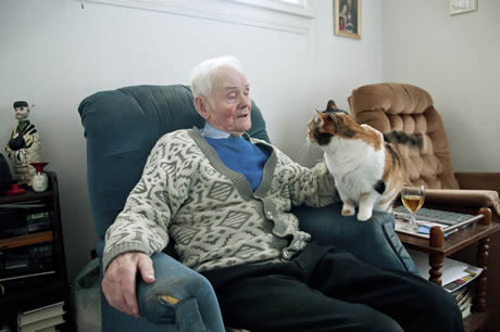Johnny Cree at home with his cat