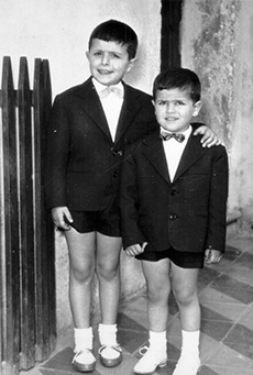 Cute picture of two little boys smiling together.