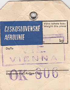 creased luggage tag stamped with the word 'Vienna'.
