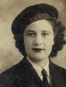 Head and shoulder portrait of a young woman wearing a military beret.