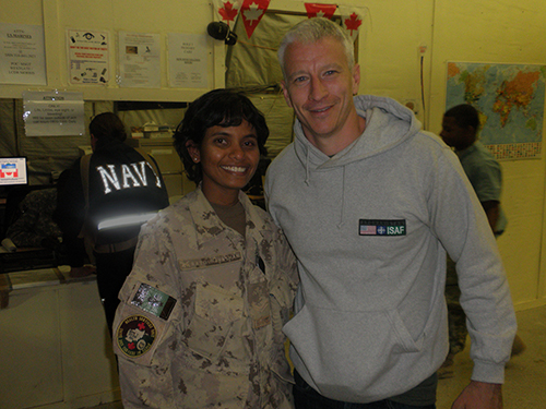 Smiling young lady wearing a Canadian Armed Forces uniform stands next to a famous news anchorman - Anderson Cooper.